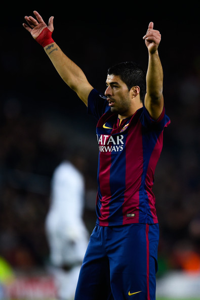 Luis Suarez of FC Barcelona reacts during the UEFA Champions League group F match between FC Barcelona and Paris Saint-Germanin FC at Camp Nou Stadium on December 10, 2014 in Barcelona, Spain.