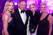 (L-R) Priscilla Waters, Group President of the Estee Lauder Companies, John Demsey, singer/songwriter Miley Cyrus, and Karen Buglisi Weiler, Global Brand President, MAC Cosmetics  attend the 23rd Annual Elton John AIDS Foundation Academy Awards Viewing Party on February 22, 2015 in Los Angeles, California.