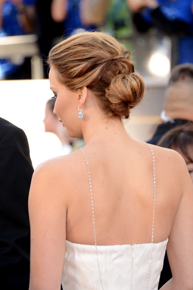 Jennifer Lawrence Actress Jennifer Lawrence (hair detail) arrives at the Oscars at Hollywood & Highland Center on February 24, 2013 in Hollywood, California.