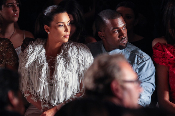Kim Kardashian Television perosnality Kim Kardashian (L) and vocalist Kanye West attend the Marchesa spring 2013 fashion show during Mercedes-Benz Fashion Week at Vanderbilt Hall at Grand Central Terminal on September 12, 2012 in New York City.