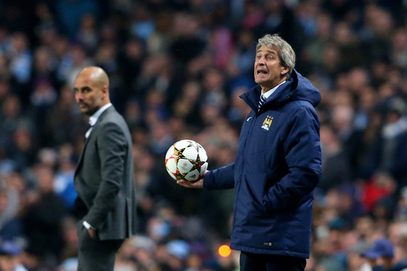 (R-L) Manuel Pellegrini the manager of Manchester City reacts as Josep Guardiola the head coach of Bayern Muenchen look on during the UEFA Champions League Group E match between Manchester City and FC Bayern Muenchen at the Etihad Stadium on November 25, 2014 in Manchester, United Kingdom.