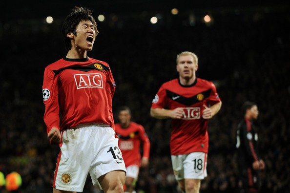 Ji-Sung Park of Manchester United celebrates scoring the third goal during the UEFA Champions League First Knockout Round, second leg match between Manchester United and AC Milan at Old Trafford on March 10, 2010 in Manchester, England.