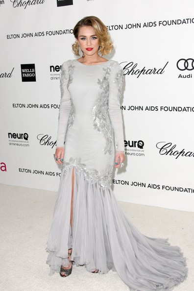 Miley Cyrus Singer Miley Cyrus arrives at the 20th Annual Elton John AIDS Foundation's Oscar Viewing Party held at West Hollywood Park on February 26, 2012 in West Hollywood, California.