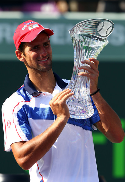 Novak Djokovic Novak Djokovic of Serbia celebrates with the trophy after he defeated Rafael Nadal of Spain during the men's singles championship at the Sony Ericsson Open at Crandon Park Tennis Center on April 3, 2011 in Key Biscayne, Florida.