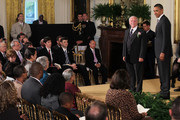 U.S. President Barack Obama (R) stand on stage as he is about to present John Keaveney (L) with a 2011 Presidential Citizens Medal during a ceremony at the East Room of the White House October 20, 2011 in Washington, DC. The medal was established for the purpose of recognizing U.S. citizens who have performed exemplary deeds of service for their country and fellow citizens.