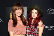 Actresses Jillian Rose Reed (R) and Nikki DeLoach attend the Pilot Pen and GBK Luxury Lounge honoring Golden Globe nominees and presenters held at the W Hollywood on January 10, 2015 in Hollywood, California.