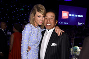 Recording artists Taylor Swift (L) and Smokey Robinson attend the Pre-GRAMMY Gala and Salute to Industry Icons honoring Martin Bandier at The Beverly Hilton Hotel on February 7, 2015 in Los Angeles, California.