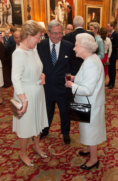 Queen Anne Marie Of Greece and King Constantine of Greece speak with Queen Elizabeth II as they arrive at a lunch in honour of Queen Elizabeth II's Diamond Jubilee, at Windsor Castle, on May 18, 2012 in Windsor, England.