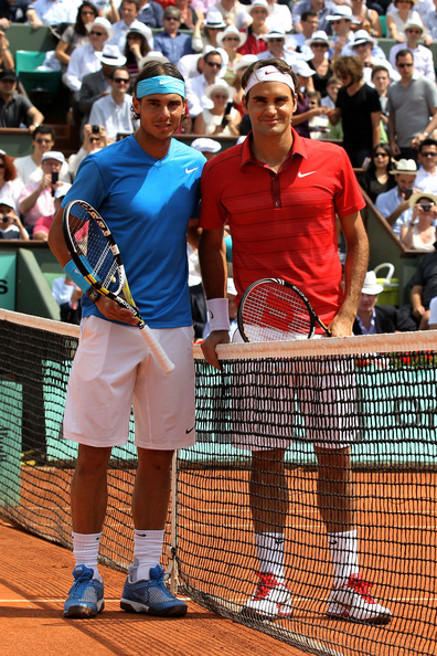 Rafael Nadal (L to R) Finalists Rafael Nadal of Spain and Roger Federer of Switzerland pose for the cameras prior to the men's singles final match between Rafael Nadal of Spain and Roger Federer of Switzerland on day fifteen of the French Open at Roland Garros on June 5, 2011 in Paris, France.