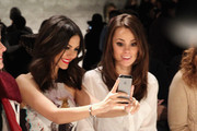 Victoria Justice (C) and stylist Madison Guest (R) attend the Rebecca Minkoff fashion show with TRESemme during Mercedes-Benz Fashion Week Fall 2015 at The Pavilion at Lincoln Center on February 13, 2015 in New York City.