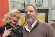 "Singer Gwen Stefani and producer Harvey Weinstein arrive on the red carpet for the premiere of TWC-Dimension's ""Paddington"" at TCL Chinese Theatre IMAX on January 10, 2015 in Hollywood, California."