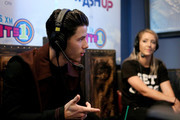 Singer-songwriter Nick Jonas (L) and YouTube personality Jenna Marbles attend Hits 1's The Morning Mash Up Broadcast from the SiriusXM Studios on February 10, 2015 in Los Angeles, California.