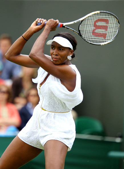 Venus Williams Venus Williams of the United States in action during her first round match Akgul Amanmuradova of Uzbekistan on Day One of the Wimbledon Lawn Tennis Championships at the All England Lawn Tennis and Croquet Club on June 20, 2011 in London, England.
