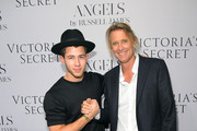 "Nick Jonas (L) and photographer Russell James attend Russell James' ""Angel"" book launch hosted by Victoria's Secret on September 10, 2014 in New York City."