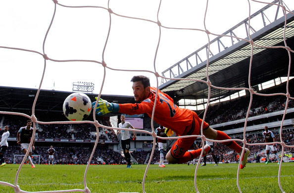 Goalkeeper Hugo Lloris of Spurs dives in vain as Stewart Downing (not shown) of West Ham scores his team's second goal during the Barclays Premier League match between West Ham United and Tottenham Hotspur at Boleyn Ground on May 3, 2014 in London, England.