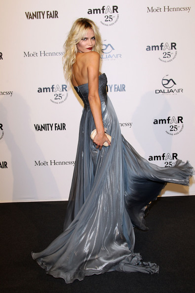 Model Natasha Poly attends amfAR MILANO 2011 at La Permanente on September 23, 2011 in Milan, Italy.