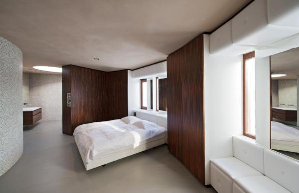 Bedroom with integrated cupboards made of rosewood and Skai leather., Image Courtesy ©  Christiaan de Bruijne