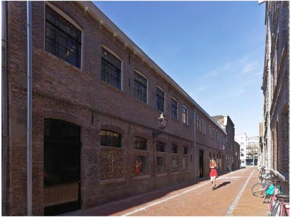 The restored brick façade of the historic factory building which now contains the foyer, Image Courtesy ©  Petra Appelhof