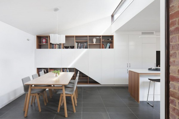 Clerestory windows lighting the space. Joinery elements defining the way the room is used by creating non-obstructed views with plain surfaces at eye level, Image Courtesy © STEFFEN WELSCH ARCHITECTS