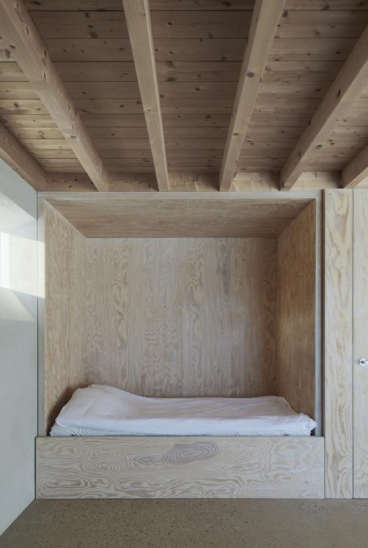Grandmother's room. Built-in box bed of waxed pine plywood. Fireplace and sliding window, Image Courtesy © Åke E: son Lindman
