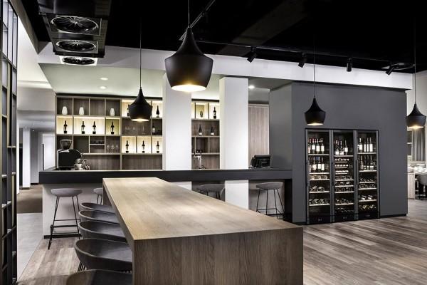 Wine bar with accessible wine cabinet, Image Courtesy © DIA – Dittel Architekten