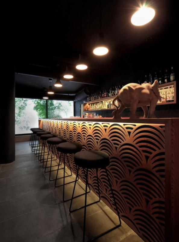the bar is located at the end of the volume allowing the focus to fall on the lounge area, Image Courtesy © Tsvetomir Dzhermanov