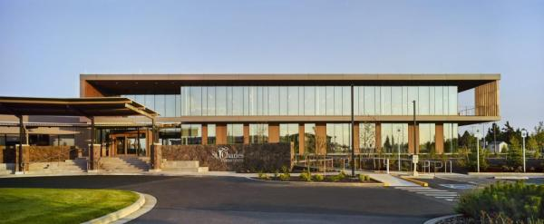 The cancer center includes a 16,000 SF addition, along with an 8,000 SF renovation in the existing hospital, and a new clinic entry that carefully blends the two buildings together. The intervention not only seamlessly connects internal building functions, it strengthens the hospital's north entry and helps set the stage for a landscape that exemplifies the regional setting, Image Courtesy © Pete Eckert