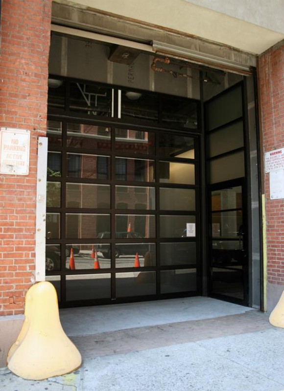 EOA worked with the New York City Landmarks Commission as well as the Greenwich Village Society for Historic Preservation on the renovation which included incorporating a glass garage door at the street level, Image Courtesy © EOA/Elmslie Osler Architect