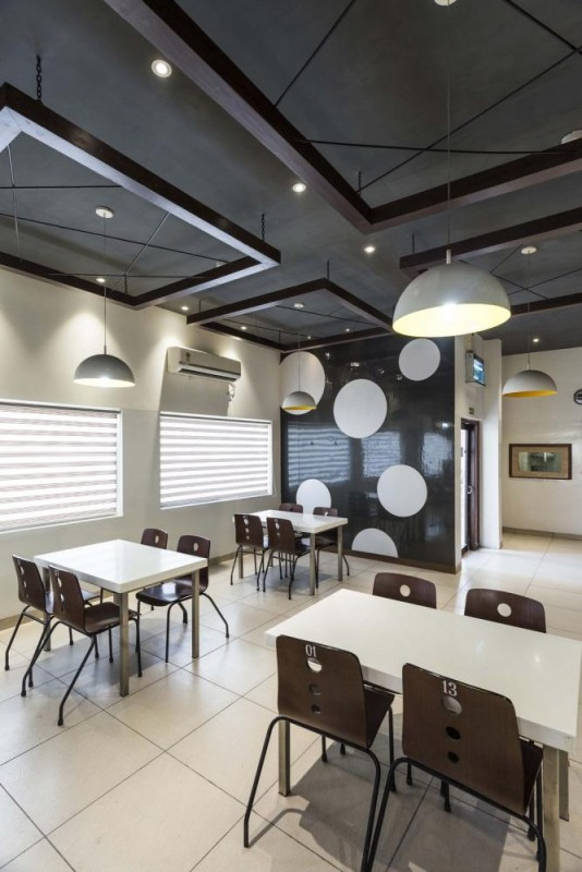 The ceiling is dark grey to contrast with the lighter floor and walls, Image Courtesy © Purnesh Dev Nikhanj