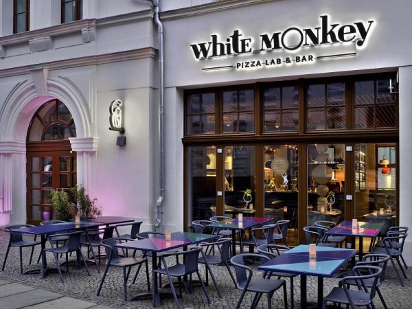 Ippolito Fleitz white monkey pizza lab bar in leipzig germany by ippolito