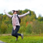 Woman jumping for joy - Covid19 threat solved by coronavirus vaccines?
