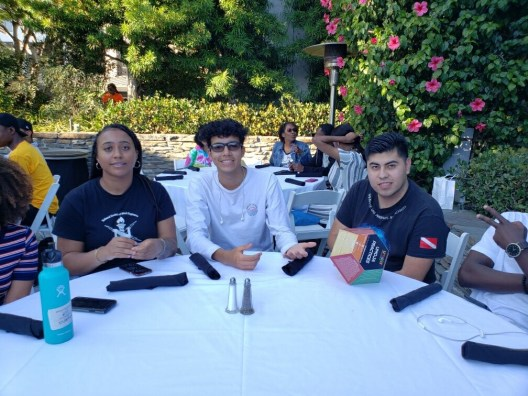 students at table eating