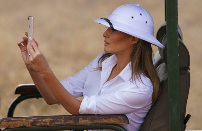 First lady Melania Trump takes photos with her cellphone at Nairobi National Park on her first visit to Africa and her first extended solo international trip as first lady.