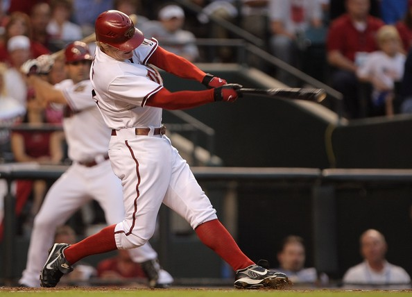 Eric Byrnes #22 of of the Arizona Diamondbacks hits an RBI double in the bottom of the first inning against the Colorado Rockies during Game One of the National League Championship Series at Chase Field on October 11, 2007 in Phoenix, Arizona. Stephen Drew #6 of the Diamondbacks scored on the play. (Photo by Doug Pensinger/Getty Images) *** Local Caption *** Eric Byrnes