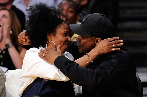 Pauletta Pearson Washington Actor Denzel Washington and wife Pauletta Pearson kiss for the 'Kiss Cam' during Game One of the Western Conference Finals during the 2009 NBA Playoffs between the Los Angeles Lakers and the Denver Nuggets at Staples Center on May 19, 2009 in Los Angeles, California. NOTE TO USER: User expressly acknowledges and agrees that, by downloading and or using this photograph, User is consenting to the terms and conditions of the Getty Images License Agreement.  (Photo by Kevork Djansezian/Getty Images) *** Local Caption *** Denzel Washington;Pauletta Pearson