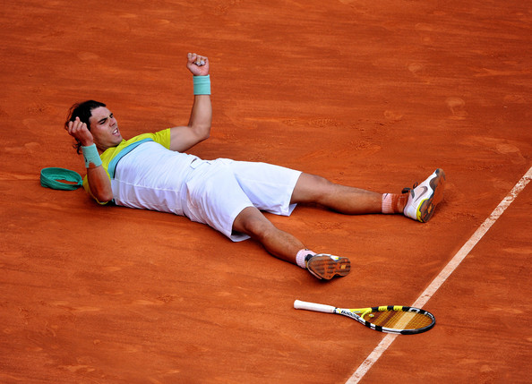 Rafael Nadal Rafael Nadal of Spain celebrates his win over Novak Djokovic of Serbia in his semi-final match during the Madrid Open tennis tournament at the Caja Magica on May 16, 2009 in Madrid, Spain. Nadal won the match in three sets, 3-6, 7-6 and 7-6.  (Photo by Jasper Juinen/Getty Images) *** Local Caption *** Rafael Nadal