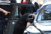 Singer Justin Bieber seen using a menu to hide his face as he rushes to his car after having lunch at Spago in Beverly Hills, California on January 24, 2015. Justin dyed his hair back to brown after rocking the platinum blonde hair for a couple of weeks.