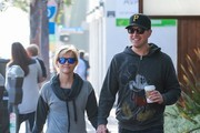 """""""Wild"""" star Reese Witherspoon makes a morning Starbucks run with her husband Jim and their son Tennessee on February 6, 2015 in Santa Monica, California. Reese will soon be featured on the cover of the 21st annual Vanity Fair Hollywood Issue, with fellow stars Amy Adams and Channing Tatum."""