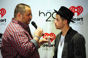 Radio personality Big D (L) and host Nick Jonas attend 101.3 KDWB's Jingle Ball 2014 presented by Sky Zone Indoor Trampoline Park and Allstate at Xcel Energy Center on December 8, 2014 in St Paul, Minnesota.