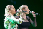 Rapper Iggy Azalea (R) and singer Rita Ora perform onstage during 103.5 KISS FM's Jingle Ball 2014 at Allstate Arena on December 18, 2014 in Chicago, Illinois.