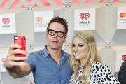 Radio personality Bobby Bones (L) and recording artist Meghan Trainor pose for a selfie photo during the 2014 iHeartRadio Music Festival at the MGM Grand Garden Arena on September 20, 2014 in Las Vegas, Nevada.