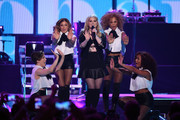 Singer Meghan Trainor (C) performs onstage during the 2014 iHeartRadio Music Festival at the MGM Grand Garden Arena on September 20, 2014 in Las Vegas, Nevada.