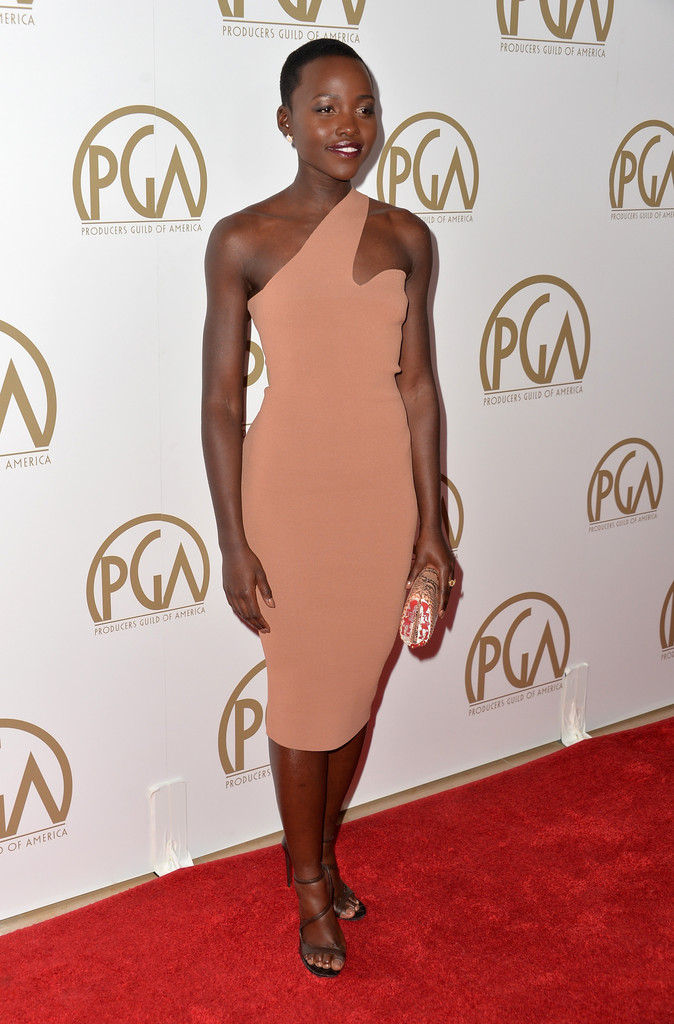 lupita in flesh tone dress
