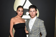 Olivia Culpo and actor/recording artist Nick Jonas attend The 57th Annual GRAMMY Awards at the STAPLES Center on February 8, 2015 in Los Angeles, California.