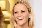 Actress Reese Witherspoon poses in the press room during the 87th Annual Academy Awards at Loews Hollywood Hotel on February 22, 2015 in Hollywood, California.