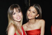 Jenette McCurdy (L) and Zendaya Coleman pose backstage at the Go Red For Women Red Dress Collection 2015 presented by Macy's fashion show during Mercedes-Benz Fashion Week Fall 2015 at The Theatre at Lincoln Center on February 12, 2015 in New York City.