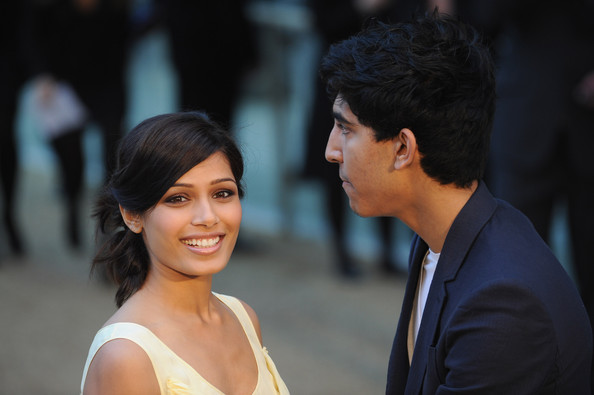 Frieda Pino and Dev Patel arrive at the Burberry  Prorsum fashion show at Rootstein Hopkins Parade Ground during London  Fashion Week on September 22, 2009 in London, England.