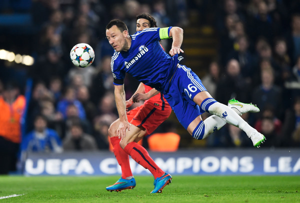 John Terry of Chelsea heads the ball clear before it can reach Edinson Cavani of PSG during the UEFA Champions League Round of 16, second leg match between Chelsea and Paris Saint-Germain at Stamford Bridge on March 11, 2015 in London, England.