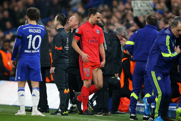 Zlatan Ibrahimovic of PSG walks off the pitch after receiving a straight red card for his tackle on Oscar of Chelsea during the UEFA Champions League Round of 16, second leg match between Chelsea and Paris Saint-Germain at Stamford Bridge on March 11, 2015 in London, England.