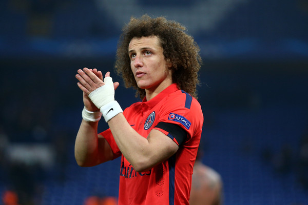 David Luiz of PSG applauds the fans following his teams victory following extra time during the UEFA Champions League Round of 16, second leg match between Chelsea and Paris Saint-Germain at Stamford Bridge on March 11, 2015 in London, England.